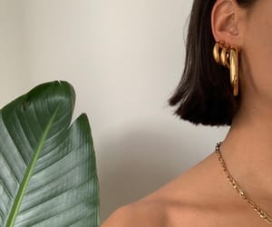green plants, gold earrings, and hipster image