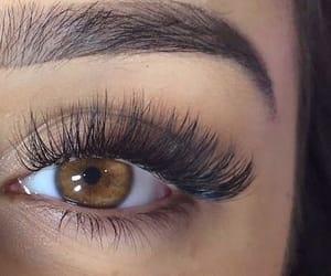brown eyes, long lashes, and makeup image