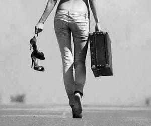 black and white, walking away, and black and white photo image
