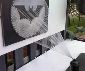 spray, string art, and bat signal image