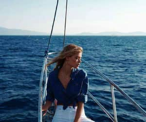 girl, boat, and sea image