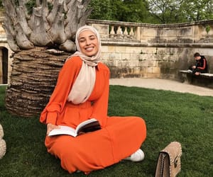 hijab, outfit, and robe image