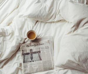 bed, coffee, and newspaper image