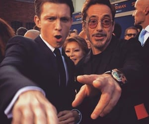tom holland, spiderman, and iron man image