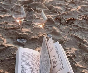 book, beach, and wine image