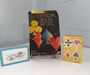 1937, deck of cards, and book image