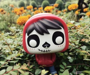 coco, flowers, and funko pop image
