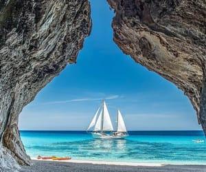beach and sailboat image