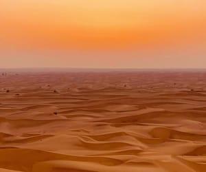 Dubai, sand, and sun image