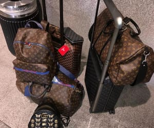 gucci, Louis Vuitton, and luggage image