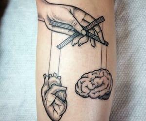 heart vs. brain tatto image