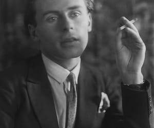 elegant, handsome, and smoking image