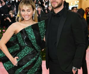 miley cyrus, liam hemsworth, and met gala image