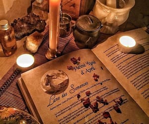 book, candle, and crystal image