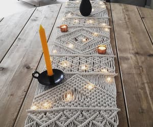 candle, lights, and tablecloth image