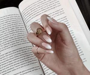 nails, book, and ring image
