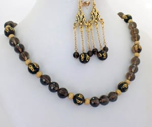 beaded necklace, chandelier earrings, and natural stone image