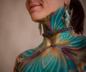 body paint, earrings, and brunette image