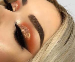 eyebrows, false eyelashes, and makeup image