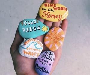 hand and rocks image