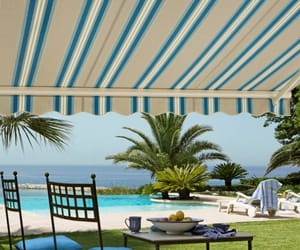 awnings, patio awning, and retractable awning image