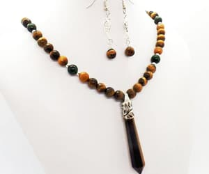 beaded necklace, pendant necklace, and natural stone image