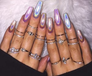 acrylics, rings, and holo image
