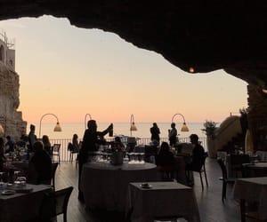 restaurant, sunset, and ocean image