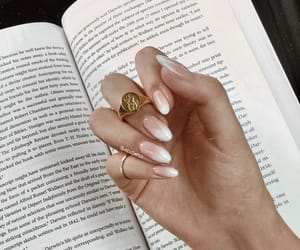 nails, book, and ring image