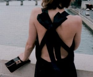 backless, twisted, and black image