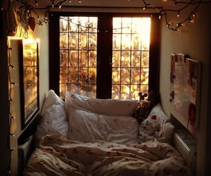 bed, blanket, and pillows image