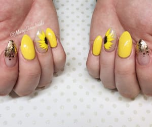 nails, sunflower, and sun image