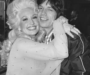 mick jagger, dolly parton, and black and white image