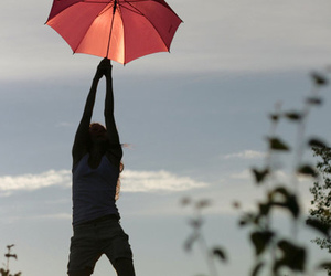umbrella siluette and girl pink clouds sky image