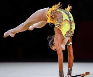 clubs, yellow, and rhythmic gymnastics image