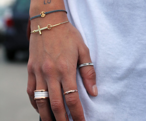 bracelet, rings, and tattoo image