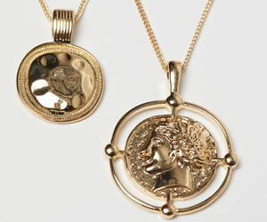 coin, H&M, and jewelry image