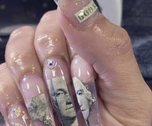 coffin, long nails, and money image