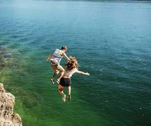 couple, jump, and sea image