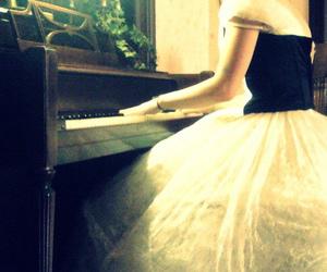 girl and piano image