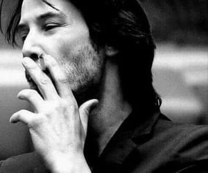 keanu reeves and cigarette image