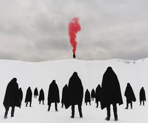 black, red, and snow image