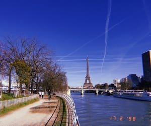 eiffel tower, tourist, and paris image