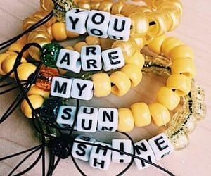 yellow, bracelet, and sunshine image