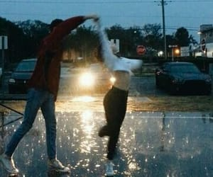 couple, rain, and dancing image