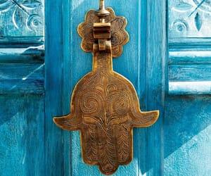 gold, blue, and hamsa image