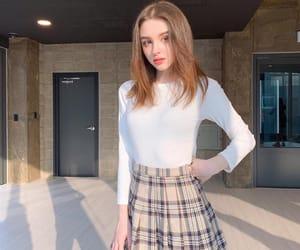plaid, pleats, and schoolgirl image