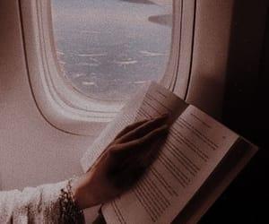 book, plane, and sky image