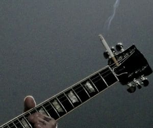guitar, cigarette, and smoke image