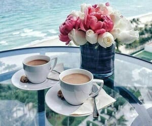 flowers, coffee, and sea image